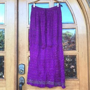 Crushed silk purple with gold long skirt.